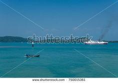 Ships sailing in a blue sea in Sunda Strait, Indonesia