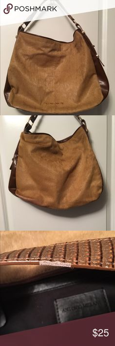 🐎Antonio Melani Fur Handbag🐎 This is a cute bag. Still has life left to it. Just don't use no more. The handle there is cracking, a few stains  in the lining inside and pocket, white mark on bottom and side toward bottom of bag, and several place where the fur is gone it is mainly around the edges of bag and  a spot on front toward upper corner. My home is smoke free I do have pets. 🚫NO TRADESS🚫 🚫NO LOW BALL OFFERS🚫 Thanks for looking😎. ANTONIO MELANI Bags Satchels