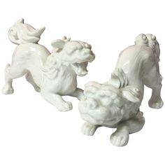 Rare Pair of White Porcelain Blanc De Chine Foo Shi Dogs by Fitz and Floyd | From a unique collection of antique and modern sculptures at https://www.1stdibs.com/furniture/decorative-objects/sculptures/