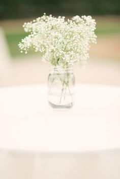Centerpieces White floral baby's breath Decor table but in a vase
