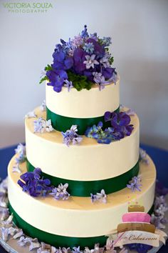 (1014) Green Ribbon Wedding Cake with Purple Flowers Photo courtesy of Victoria Souza Photography