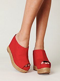 On the way to the beach...red woven covered heel, open toe.