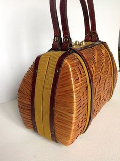 Lovely woven cane bag with burgundy leather, mustard color textile in good vintage condition.    the woven cane, leather and fabric look gorgeous