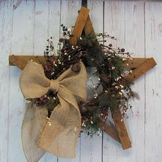 LAST ONE AND READY TO SHIP! - Here is a great gift item for your friend or family member. This rustic tobacco lathe star is decorated with a primitive pine garland with red/green/ivory berries, jingle bells and accented with a natural brown burlap bow. Measurements: Approximately 23-24 Wide by 23-24 Tall by 4.5-5.5 Deep ~~~ CHECK OUT MY OTHER RUSTIC STAR ITEMS I HAVE FOR SALE IN MY ETSY STORE BY CLICKING ON THE LINK BELOW: https://www.etsy.com/shop/Designawrea...