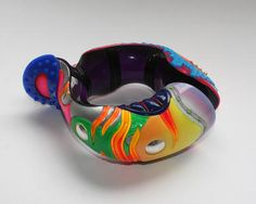 Peter Chang is a sculptor; complex brightly coloured pieces which can be worn or can simply exist as objects in their own right.  ~  Bracelet ~ Acrylic, PVC, resin