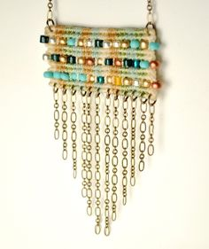 by AMiRAjewelry on Etsy.  Nice interplay between fiber and chain
