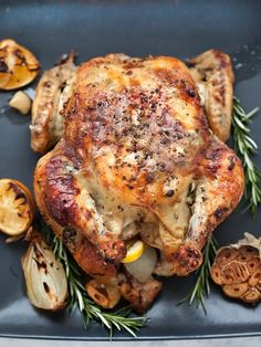 Oven Roasted Chicken with Lemon Garlic Butter is a super easy dinner and everyone's favorite | foodiecrush.com