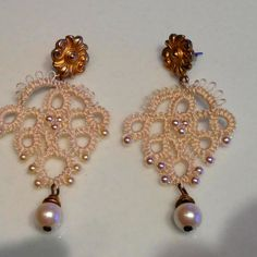 "Tatting using DMC cordonet 20, vintage Japanese beads and an old pair of earrings that were ""decomissioned""."