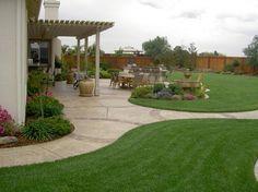 Charming Simple Backyard Designs Present Peaceful Scenery: Simple Backyard Designs Colorful Flowers Elegant Pergola Outdoor Furniture ~ dickoatts.com Dream Home Designs Inspiration