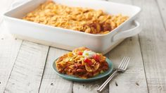 Fritos Chili Pie Bake - This easy Fritos™ chili pie knows how to impress! With taco-seasoned ground beef and a saucy pinto bean mix, plus all the Fritos™ corn chips you can handle, it's a guaranteed winner dinner. Casserole Dishes, Casserole Recipes, Meat Recipes, Mexican Food Recipes, Dinner Recipes, Cooking Recipes, Hamburger Recipes, Mexican Dishes, Chili Casserole