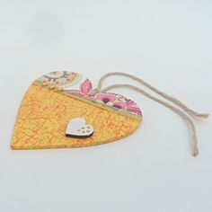Decorated wooden hanging heart - orange £2.00