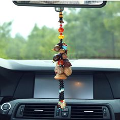 5.  Decoration hanging in the car      In China, so many people like to hang some decorations/mascot/amulet on the rearview mirror. They might have a new definition/meaning in the future?