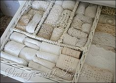 Clever way to store lace and ribbon in a wicker cutlery tray.