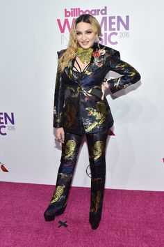 Madonna Pantsuit - Madonna hit the Billboard Women in Music 2016 rocking a tiger-print jacquard pantsuit by Gucci.