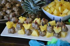 Rum Glazed Meatball Skewers- Tropical meatballs with coconut and pineapple in a delicious captain morgan rum glaze!
