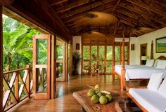 Deep in Jamaica's rainforest, Kanopi House hotel is the place to fulfill fantasies of sky-high treehouse living, surrounded by cloud-sweeping, vine-entangled banyan trees.