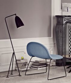 Love this lamp by Gubi.  Perfect as a bedside but not take up any space on the table!