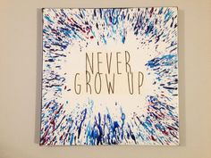 Never Grow Up Melted Crayon Art Quote on by HappyBrainDesign Canvas Art