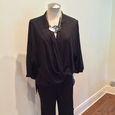 Elan criss cross top black criss cross front longer in the back new with tags from m. fredric Elan Tops Blouses