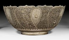 AN IMPRESSIVE DOUBLE WALLED SILVER BOWL WITH ENGRAVED AND OPENWORK DESIGN  Thailand, ca. 1940.  diameter 60 cm.