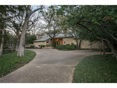 Unique modern home-almost an acre in Preston Hollow Estate area.Trees,dogwoods,azaleas,lrg covered cabana,outdoor blue slate patio&WBFP give non-urban feel close to downtown.Glass entry w floating stairs on interior brick wall. Back Glass walls. Multi vaulted ceilings & sep. patios create sense of space.Mstr suite:study w oak bookcases&FP,sep. baths,closets,access to pool. Kitchen-bkfst rm SS frig-freezer, gas cooktop etc. Solid oak cabinet