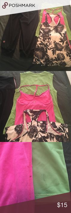 Lululemon 4 items size 6-8 Lululemon crop pants, flower print tank, pink tank, and green tank. None have tags but my better guess it that they are all either size 6 or 8. All been loved and worn but still have life left in them. Pants have a few piling on seams. Pictures show minor stains on tanks. Flower tank has faded on white areas. Great price for all of them! lululemon athletica Tops Tank Tops