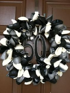 Balloon wreath for 50th birthday party decorations.  See more decorations and 50th birthday party ideas at www.one-stop-party-ideas.com