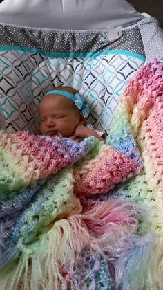 Hairpin lace rainbow blanket made with Bernat Baby Coordinates