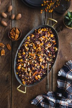 Pecan Wild Rice Pilaf | Made with a blend of wild & black rice seasoned with warm fall spices. Caramelized butternut squash, apples, and buttery pecans add flavor, texture, and crunch.