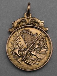 Lovely 9 carat gold music prize medallion decorated with crisp and