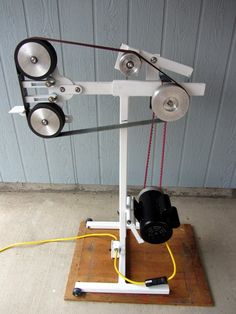 Belt Grinder by Ken Reed -- Homemade belt grinder constructed from commercial components and steel stock. Powered by a 1.5 HP 120V motor. http://www.homemadetools.net/homemade-belt-grinder-38