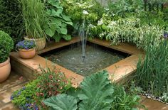 Small square raised water feature pond pool fountain Design: Jeff Whiten Real Life by Bretts RHS Chelsea Flower Show 2008 Marcus Harpur / #waterfeature #pond #fountain / Via: http://harpurgardenimages.thirdlight.com/viewpicture.tlx?containerid=126621&pictureid=6712559