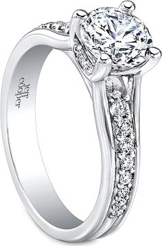 Jeff Cooper Prong Set Diamond Engagement Ring : This diamond engagement ring setting by Jeff Cooper features round brilliant cut diamonds set along the shank going under a four prong basket holding the center stone of your choice. Jeff Cooper, Prong Set, Shank, Diamond Engagement Rings, Diamonds, Basket, Wedding, Jewelry, Valentines Day Weddings