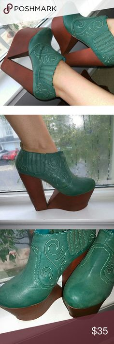 These boots. Amazing teal cowboy cut out platforms Teal faux leather platform boots with cowboy bootie style design and stitching. Worn once near perfect condition with a slight scuff shown on picture four. Total showstoppers. privalege Shoes Platforms