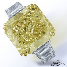 Fancy yellow radiant cut diamond with emerald cut diamonds.  By JB Star.  Avaiable at Alson Jewlelers.
