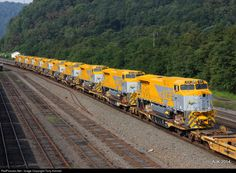 RailPictures.Net Photo: CLN 1838 Norfolk Southern BB40-9W at Johnstown, Pennsylvania by Tony Kimmel.  NS 056 had quite the train on 8/18/2014, amongst the CAT equipment, pipe loads, and Trucks for these units, were these 10 brand new BB40-9W GE's, heading for Mozambique,Africa.. Photo at Johnstown,Pa.