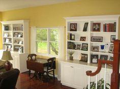Family rm. built-ins with plain stiles, straight valances, raised panel doors.