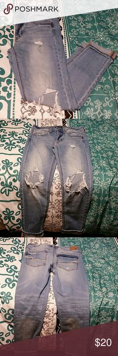 American Eagle jeans Size 4 stretch , distressed jeans . Button up as shown in last picture. Two large knee holes (came this way). American Eagle Outfitters Jeans Skinny
