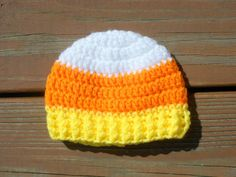 Here is a darling crocheted baby / child candy corn colored hat found right here on Etsy! This hat will be hand-crocheted with care using 100% acrylic yarn and comes in a variety of sizes. Makes a really cute autumn photo prop or baby shower gift. (This listing on Etsy is for made-to-order only so the hat is not yet made.)  SIZE OPTIONS: (All Sizes are Approximate and include Hat Circumference and Hat Height Measurements) Newborn: 13.5 Circumference ~ 4.5 Tall 3 Months: 14 Circumference ~ 5…
