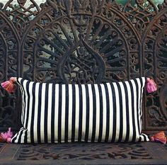 black and white pillow with  pink tassels
