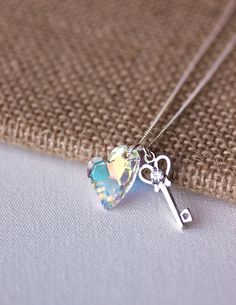 Key to My Heart Necklace - Swarovski Crystal Asymmetrical Devoted 2 U Heart Necklace, Silver Key Necklace,Sterling Silver,Gift for Her. $28.50, via Etsy.