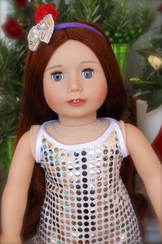 Our 18 inch Doll, Lyric, with long chestnut red hair, wearing a holiday party dress that fits American Girl.. available at www.harmonyclubdolls.com