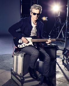 Wears shades, plays the electric guitar, and apparently Capaldi also draws. Twelve is SO my Doctor :)