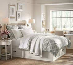 Stratton Bed with Drawers | Pottery Barns.  Under bed storage perfect for extra linens and blankets in Guest Room.  Like the desk area under the window with photos on the walls.