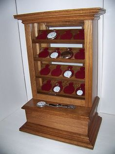 Countertop pocket watch display case, railroad grade oak two drawer, displays 16