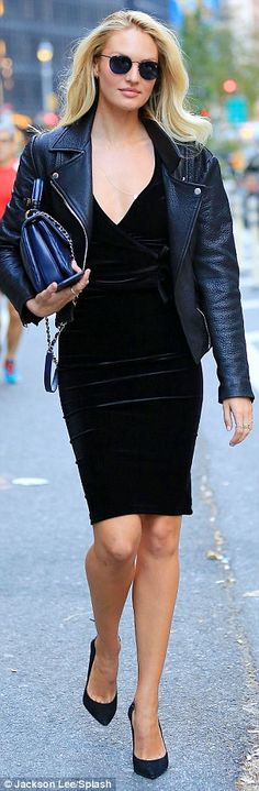 Street chic: The model sported a tight velvet dress paired with a leather biker jacket and...