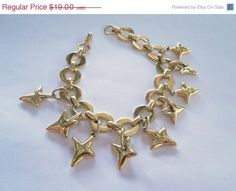 https://www.etsy.com/listing/185248691/huge-sale-golden-stars-vintage-bracelet
