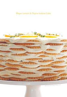 Meyer Lemon Thyme Icebox Cake Recipe --This turned out great! I made it in a cake pan which wasn't as pretty but more transportable. The candied lemons added a lot! Köstliche Desserts, Delicious Desserts, Dessert Recipes, Yummy Food, Impressive Desserts, Meyer Lemon Recipes, Icebox Cake Recipes, How Sweet Eats, C'est Bon