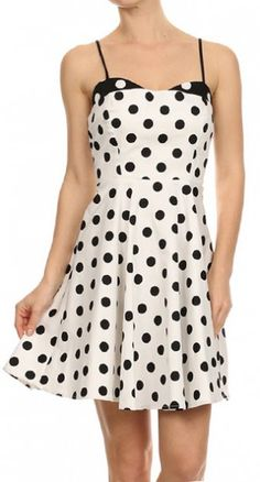 You will look as sweet as can be in the Two Tone Polka Dot Pinup Dress in White and Black!