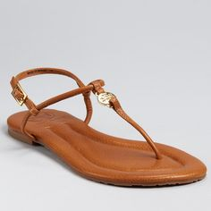 Tory Burch Emmy Flat Logo Sandals in Chestnut Excellent condition. Only worn a few times.   Simply the essence of chic, easy summer style, these slim-strapped flats are equally at home on city streets and sandy beaches.   Leather upper, leather lining, synthetic sole Imported T strap vamp, buckled ankle strap Front logo detail Tory Burch Shoes Sandals